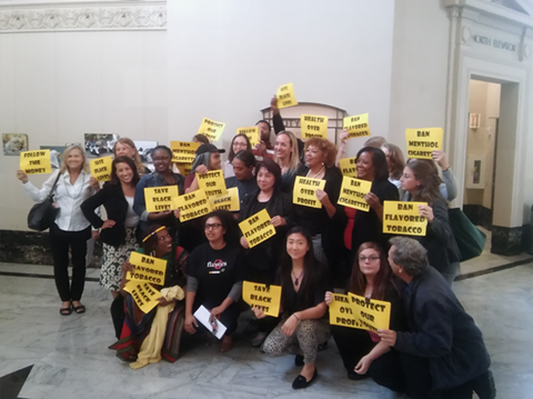 Councilmember Annie Campbell Washington poses for a picture with anti-tobacco advocates at last night's meeting.