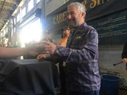 Sierra Nevada founder Ken Grossman poured brews for hours, and — like a rock star — even snapped photos with many adoring fans, at this past weekend's Beer Camp festival in San Francisco. - PHOTO BY NICK MILLER