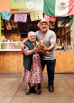 Luis Abundis (right) and his mom hold a sandiloca, the dessert of the summer at Nieves Cinco De Mayo. - PHOTO BY SAM ZIDE
