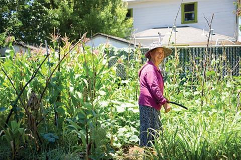 Mey Yan Saechao, one of the Mien gardeners. - PHOTO BY BRIAN BRENEMAN