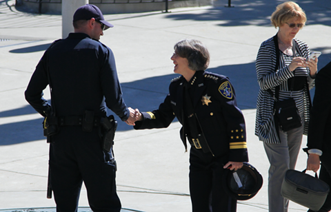 Police Chief Anne Kirkpatrick greets a police officer. - ALI WINSTON