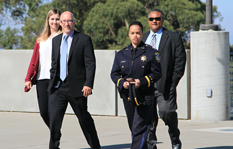 Captain Kirk Coleman (right) arrives with Deputy Chief Danielle Outlaw and Director of Research and Planning Timothy Birch.