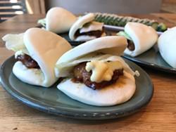 Ippudo's most popular appetizer, the pork belly buns. - JANELLE BITKER