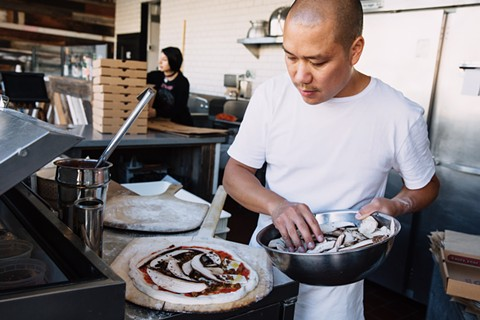 Viet Nguyen is living his pizza-making dream. - ANDRIA LO