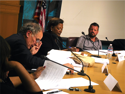 From left to right: selection panel members Jim Chanin, Candice Jesse, and Tal Klement deliberate over police commission candidates.