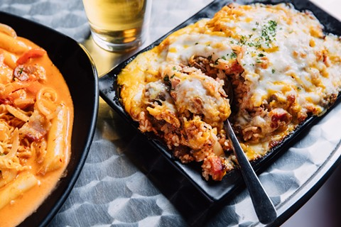 Azit's signature rice dish features kimchi, two kinds of meat, and lots of stretchy, melty cheese. - ANDRIA LO