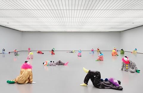 Clowns in repose in Ugo Rondinon's installation vocabulary of solitude. - COURTESY OF BAMPFA