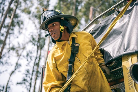 Paul Mason listens to an officer during a wildland training exercise in the Oakland hills. Since the 1991 firestorm, academy recruits are rigorously trained on more extensive wildland firefighting equipment. - ROSA FURNEAUX
