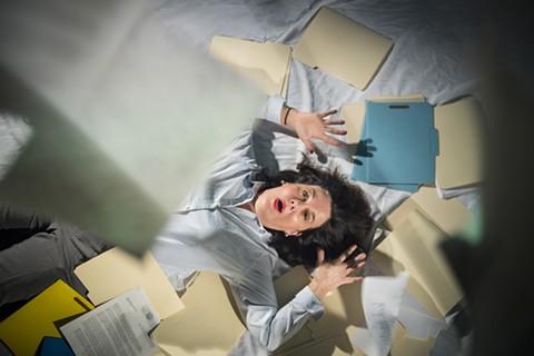 Exasperated social worker Caroline (Jamie Jones) drowns in paperwork in Aurora's Bay Area Premiere of Luna Gale. - PHOTO BY DAVID ALLEN