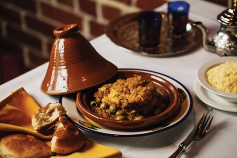 The chicken tajine's golden hue comes from preserved lemon. - PHOTO BY ANDRIA LO