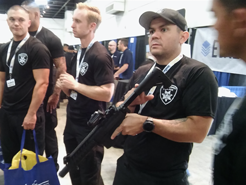 Oakland SWAT team members try out guns at this year's Urban Shield.