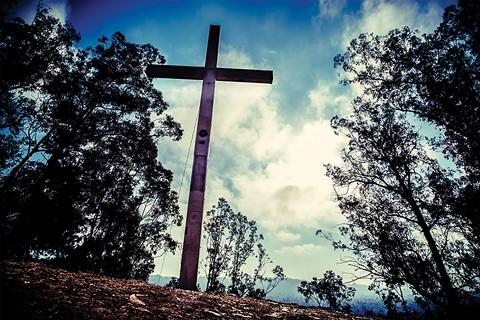 The Albany Lions Club has steadfastly refused to remove a giant cross on Albany hill. - PHOTO BY DARRYL BARNES