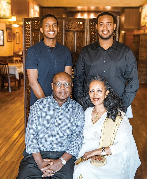 Brothers Yonathan Yohannes and Benyam Yohannes (top left-to-right) might run Asmara Restaurant one day. That's what their parents Kesete Yohannes and Okba R. Yohannes hope for, at least. - PHOTO BY KALA MINKO