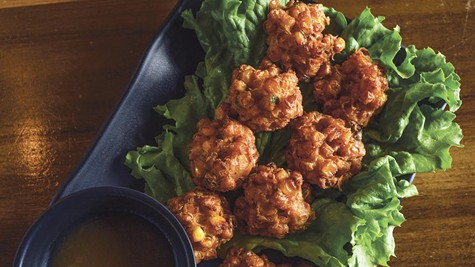 Corn fritters with plum sauce are a recipe from a friend, the Laotian-American chef James Syhabout.
