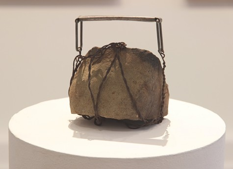 Portable Burden turns a rock into a purse.