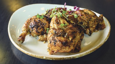 The herb-roasted chicken alone is worth a trip.
