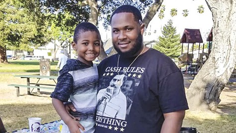 Dujuan Armstrong and his son.