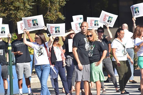 CALL FOR JUSTICE: Miles Hall's parents, Scott and Tawn Hall (foreground, center), at a recent demonstration.