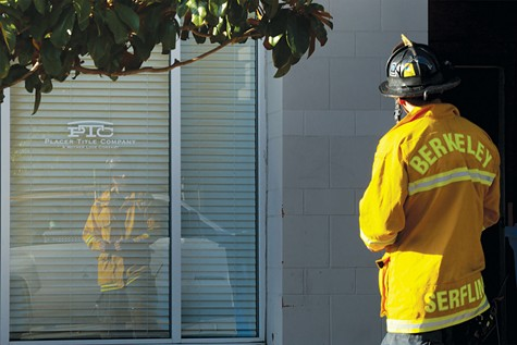 BURN OUT: A Berkeley firefighter stands in reflection.