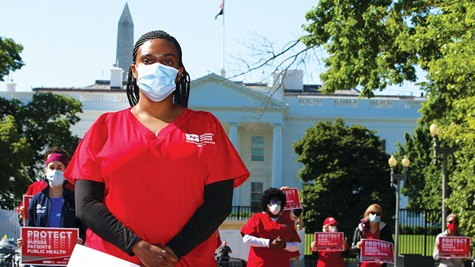 PROTEST: A member of National Nurses United protests outside of The White House