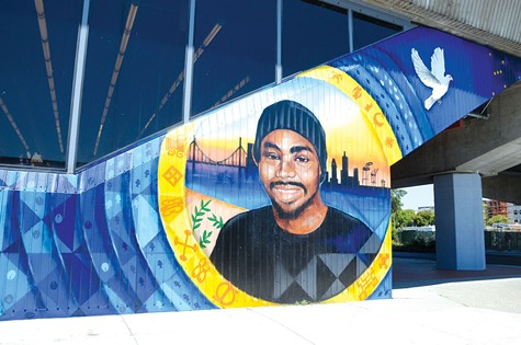 NOT FORGOTTEN: A mural at Fruitvale Station celebrates the life of Oscar Grant, who was killed on a train platform by a BART police officer on New Year's Day in 2009.