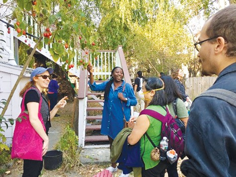 HOUSING HOPES:  People look at prospective projects as they take an  Northern California Community Land Trust housing tour.