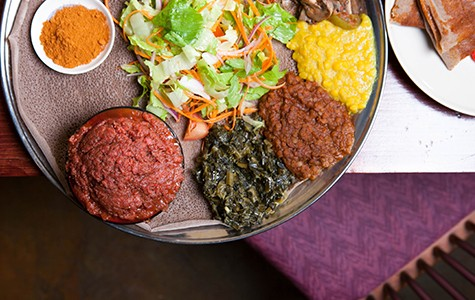 The injera forms the edible base for each family-style platter.