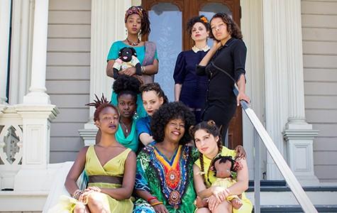 Regina Evans (center) with models Chinasa Porter, Olivia Krause, Jasmine Gaines, Mesiah Burgiaga-Hameed, Sarah Melekova, Nesbyth Rieman, and JahniahOmi Bahari.