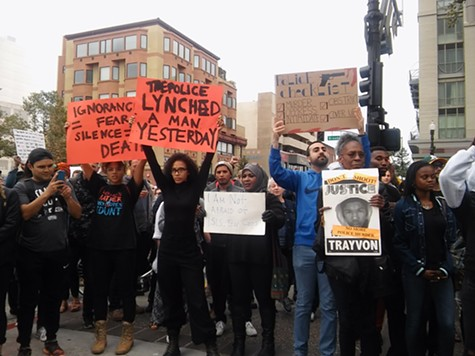 Protesters outside the Oakland police headquarters in July.