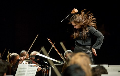 Berkeley Symphony music director Joana Carneiro in the midst of conducting. Courtesy Squid Inc.