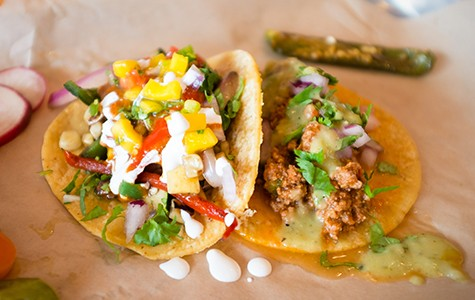 Two carne molida tacos — the one on the left is topped with mango pico de gallo.Bert Johnson