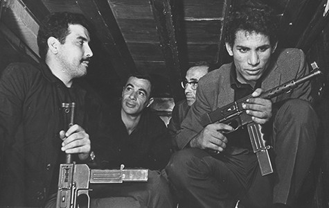 Saadi Yacef (second from left) and Brahim Haggiag (right) in The Battle of Algiers.