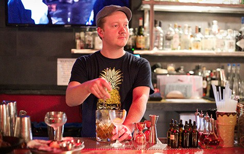 Bartender Liam Gilmore prepares a drink at Blind Tiger — but all we can think about are the happy-hour oysters.
