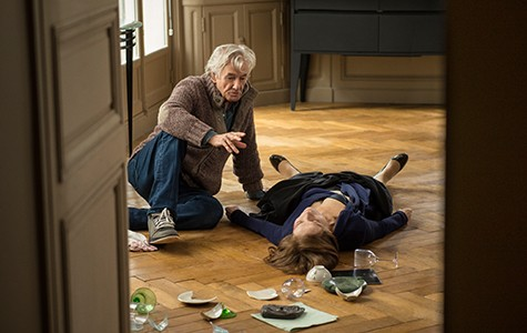 Paul Verhoeven (left) directing Isabelle Huppert.