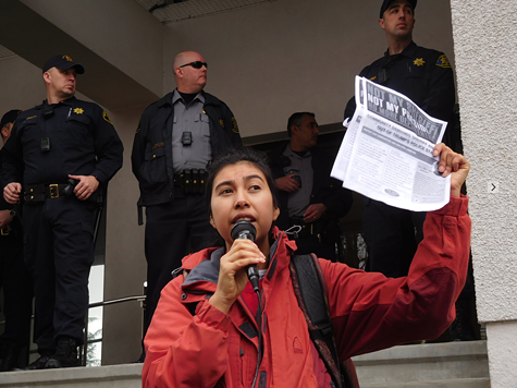 Kitzia Esteva of the Alameda County United in Defense of Immigrants Rights coalition outside the sheriff's office in Oakland.
