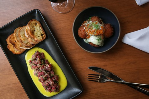 Steak tartare with hollandaise (left) and pommes dauphine with trout roe.