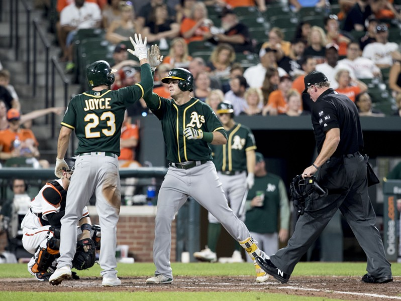 Why are the A's shopping Ryon Healy (center), one of their best young stars?