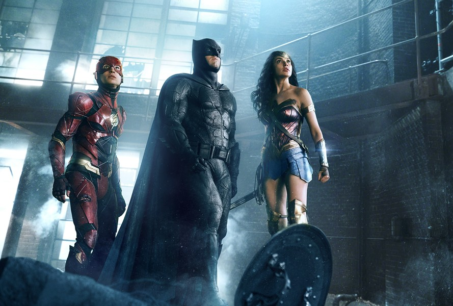 Ezra Miller, Ben Affleck, and Gal Gadot team up in Justice League.