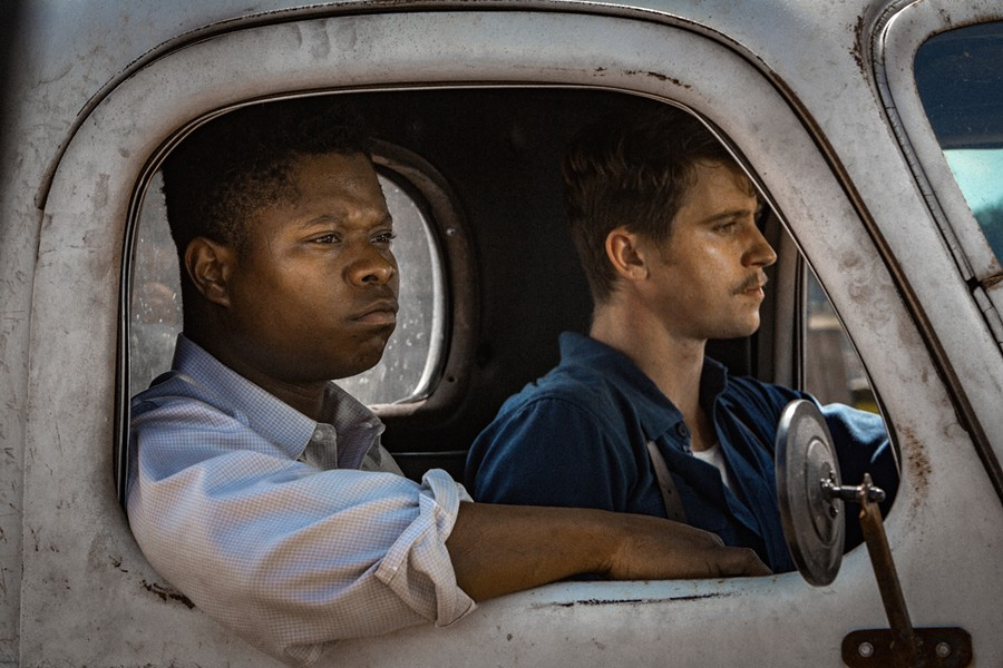 Jason Mitchell (left) and Garrett Hedlund fraternize in Mudbound.