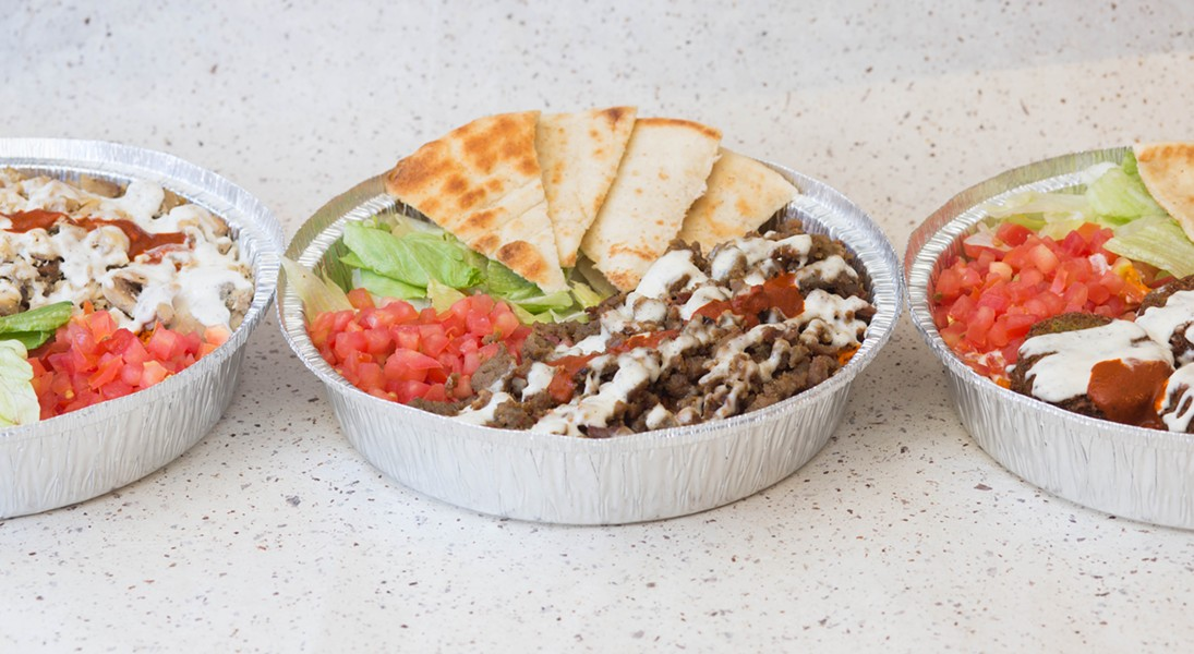 From left to right: platters of chicken, gyro meat, and falafel with red and white sauce. - PHOTO COURTESY OF THE HALAL GUYS