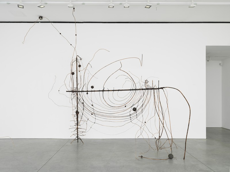 """Heikes' """"Couper l'oeil,"""" a massive sculpture composed of copper, wax, aluminum foil, steel, steel slag, cast bronze, and iron, evokes a wire fence unraveling at the seams. - COURTESY OF BAMPFA"""