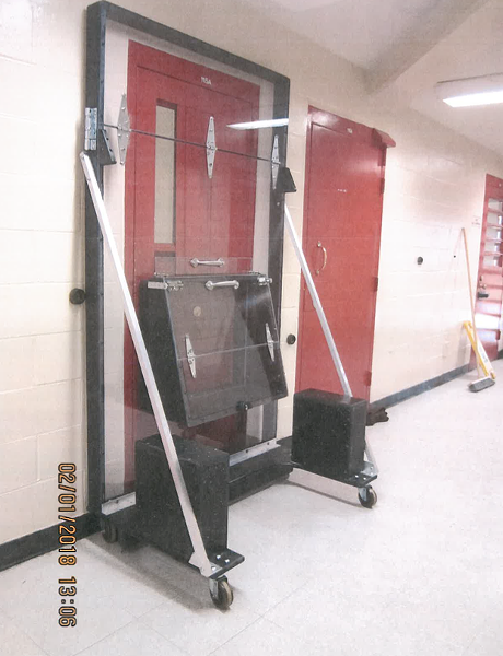 """A plexiglass shield used to protect jail staff from """"gassing"""" attacks. - COURTESY OF ALAMEDA COUNTY SHERIFF'S OFFICE."""