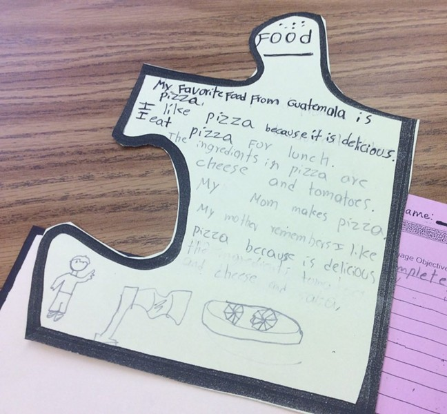 """Students in a """"Survival English"""" class at Oakland International High describe their favorite foods as part of a writing project focused on their identities. - THERESA HARRINGTON FOR EDSOURCE"""