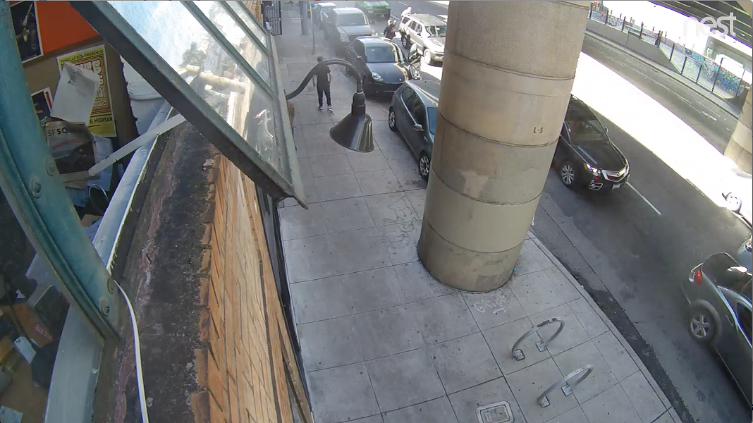 A screenshot of the security video showing Jason Perkins spraying a homeless man with what he said was mace.