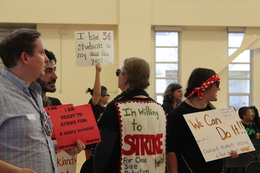 Teachers threaten to strike at Oakland school board meeting on May 9, 2018. - PHOTO BY THERESA HARRINGTON FOR EDSOURCE