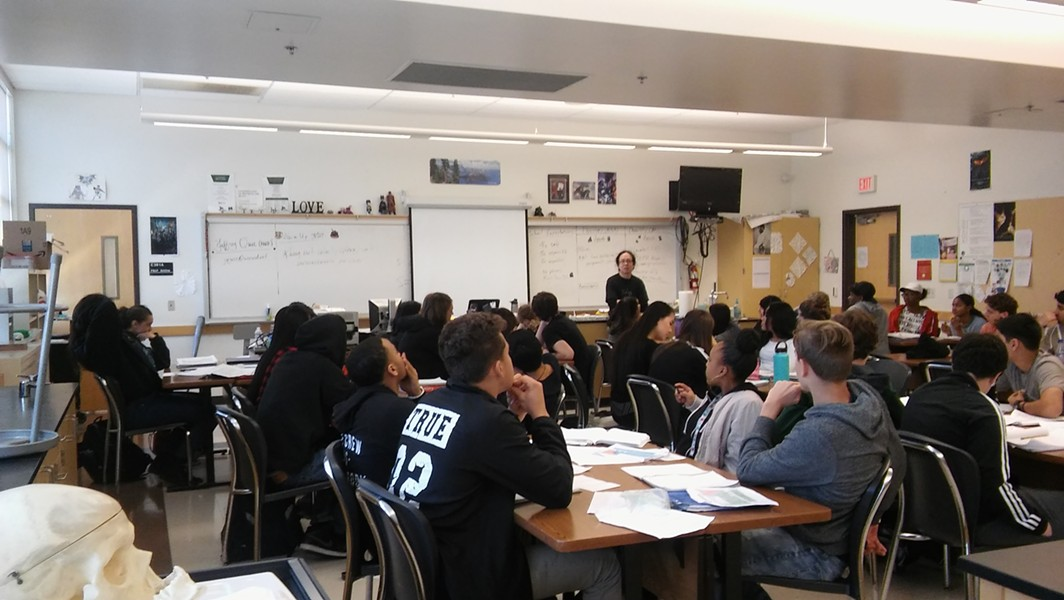 Thirty-six students sit at 10 tables in a chemistry classroom at El Cerrito High. A new United Teachers of Richmond contract with West Contra Costa Unified caps core classes in middle and high schools at this amount. - THERESA HARRINGTON FOR EDSOURCE
