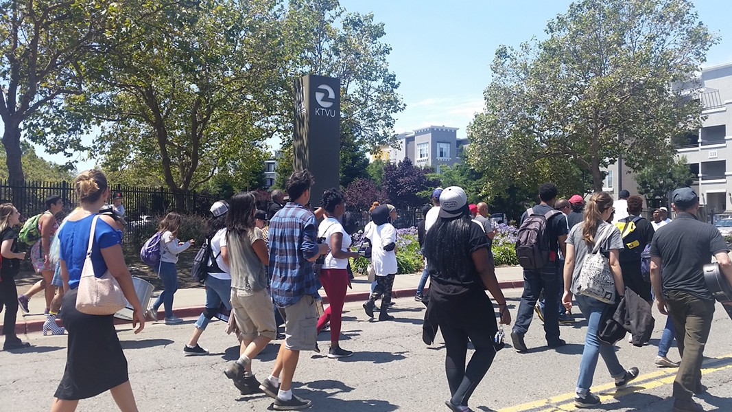 """Protesters marched to the offices of KTVU in Jack London, demanding accountability for the local news station's use of what they called a """"dehumanizing"""" photo. - JOSH SLOWICZEK"""