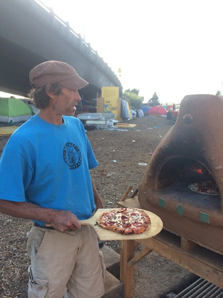 Miguel Elliott made The Village's cob oven. - PHOTO COURTESY OF MOMO CHANG