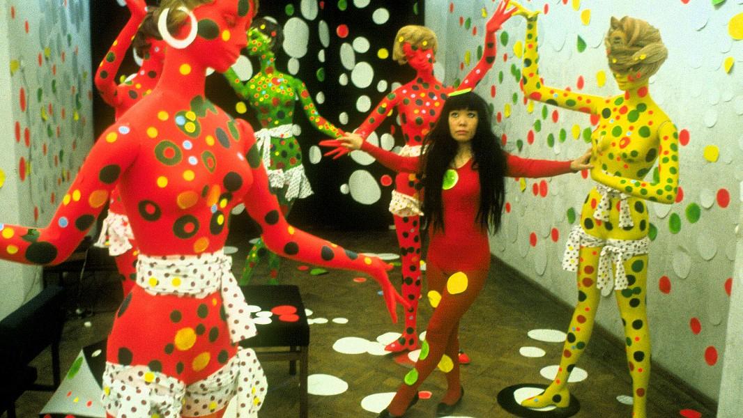 Yayoi Kusama interacts with an installation, circa 1965, in Kusama – Infinity. - PHOTO BY HARRIE VERSTAPPEN