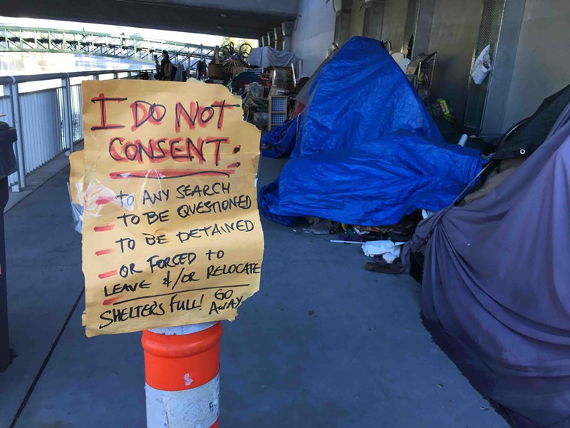 Some homeless residents living under the 12th Street Bridge do not want to move or participate in the city's Tuff Shed program.